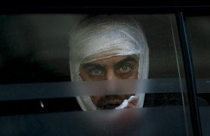A wounded Ukrainian soldier looks through a windows as he arrives to a hospital in Artemivsk