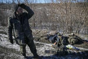 Ukrainian serviceman reacts as he leaves Debaltseve