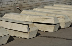 Coffins with bodies of killed Ukrainian soldiers are pictured outside a morgue in Artemivsk