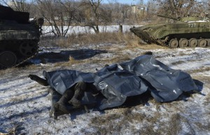 Bodies of Ukrainian soldiers killed in Debaltseve are pictured on stretchers at a military camp in Artemivsk