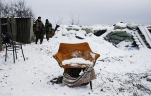 Pro-Russian separatists stand behind an armchair at a checkpoint used by Ukrainian government troops on the outskirts of Vuhlehirsk, eastern Ukraine