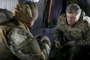 Ukraine's President Poroshenko talks to Chief of Staff of Ukraine's Armed Forces Viktor Muzhenko aboard a helicopter as they travel to Artemivsk to meet servicemen