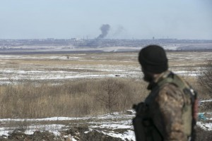 A fighter with the separatist self-proclaimed Donetsk People's Republic Army walks in the town of Vuhlehirsk