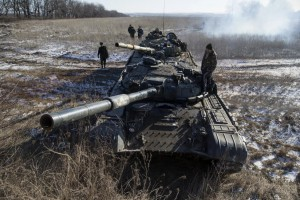 Tank crew of the separatist self-proclaimed Donetsk People's Republic Army stand on top of their tanks at a checkpoint on the road from the Vuhlehirsk to Debaltseve