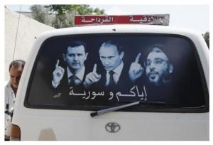 """Постер с изображениями президента Сирии Башара Асада, президента РФ Владимира Путина и лидера """"Хезболлы"""" Хасана Насраллы на стекле микроавтобуса в сирийском городе аль-Кардахах. 26 мая 2014 года. Российские военные эксперты в Сирии стали более заметны в этом году, сообщил в среду сирийский военный чиновник, после того как Москва подтвердила присутствие там военных специалистов из России, помогающих осваивать армейскую технику. REUTERS/Khaled al-Hariri"""
